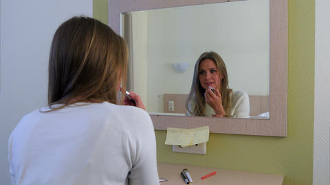 Morning routine of girl applying make-up before going to a meeting Footage