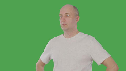 Bald man nodding head and agreeing with conversation isolated on green Live Action