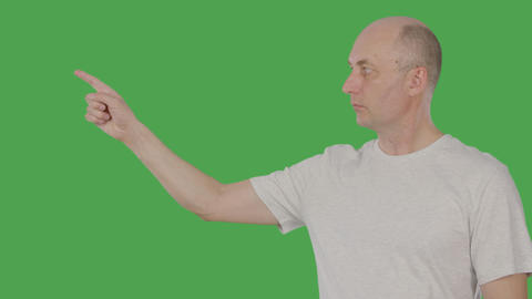 Caucasian man pointing forefinger for showing or presenting something isolated Footage