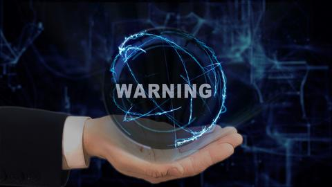Painted hand shows concept hologram Warning on his hand Fotografía