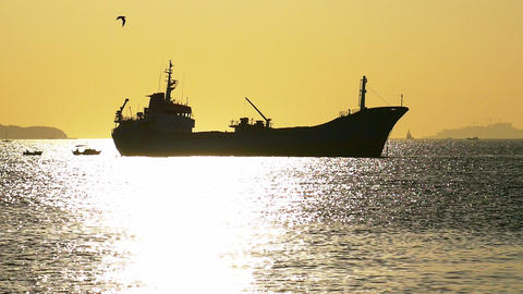 Silhouette of a ship anchored in Marmara Sea, towards Islands. Cargo ship or Footage