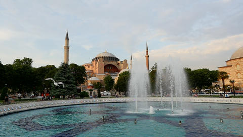 Slow motion birds fly over Hagia Sophia (Aya Sofya) museum and fountain view Footage