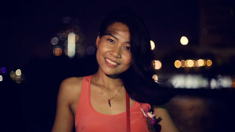 Portrait of young woman with hair in wind while night river cruise slow motion Footage