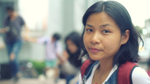 Asian Girl eating meat on skewers in Bangkok toned video Footage
