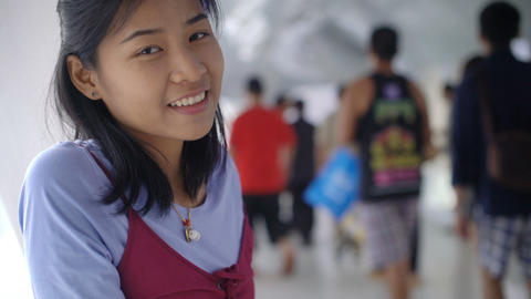Portrait of smiling young asian girl in office building Footage