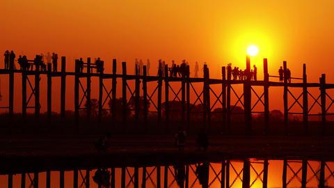 Famous U-Bein teak bridge at sunset, timelapse Footage