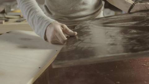 Professional woodworker connects two wooden polished board. Furniture. Process Live Action