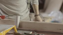 Woodworker dye varnish long wooden board by production roller. Manufacturer Live Action