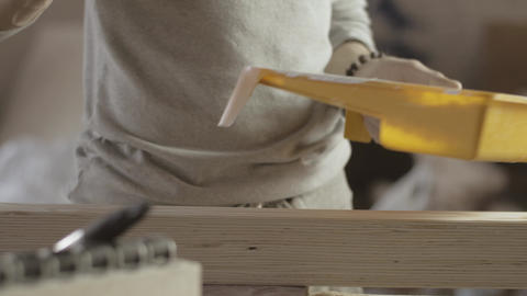 Woodworker paint varnish long wooden board by brush, roller. Manufacturer Live Action