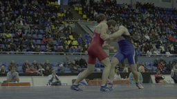 Men wrestlers fight each other in the championship Stock Video Footage