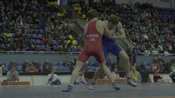 Men wrestlers fight each other in the championship Footage