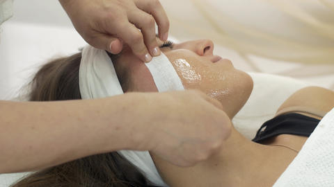 Close up of cosmetologist hands make epilation of girl face in beauty saloon Live Action