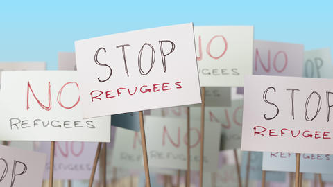 STOP REFUGEES placards at street demonstration. Conceptual loopable animation Footage