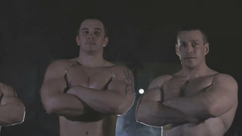 Bodybuilders are three of us, behind the veil dysovaya Footage