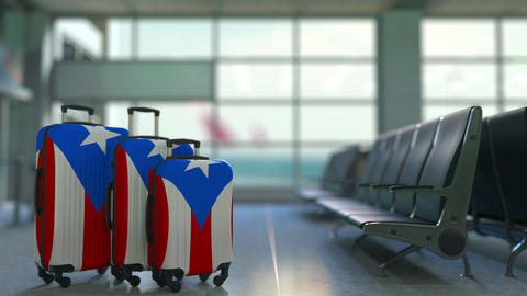 Travel suitcases featuring flag of Puerto Rico. Puerto Rican tourism conceptual Footage