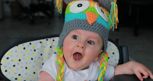 Beautiful Baby With A Funny Wool Hat On The Head Footage