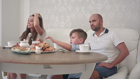 Happy family playing together while having breakfast at the restaurant table Footage