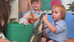 Two baby boys playing with toys in their nursery room Footage