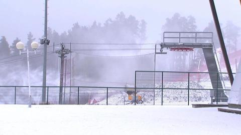 Snow cannon pours snow on ski slope 2 Live Action