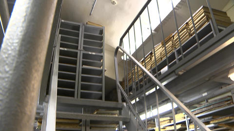 Archive with books, metal staircase in the library Footage