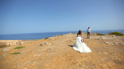 Beautiful bride and groom on the beach on their wedding day Footage