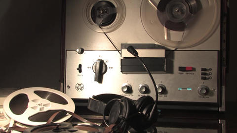 recording on a reel to reel tape recorder Live Action
