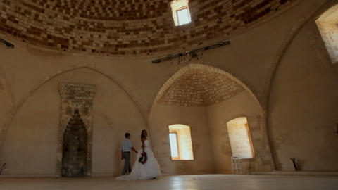 Romantic photosession of the bride and groom near the old castle Footage