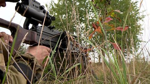 The soldier fires a machine gun Footage