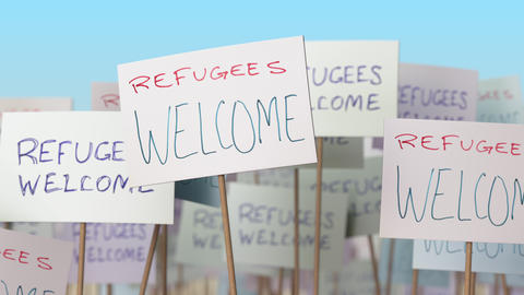 REFUGEES WELCOME placards at street demonstration. Conceptual loopable animation Live Action