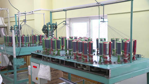 Garment manufacturing, with the coils coming off the thread, the General plan Live Action