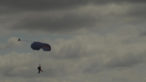 Parachutist lands.The paraglider descends in cloudy weather. Active lifestyle Live Action