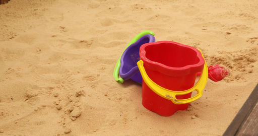 Children toys buckets, spade and shovel on sand Footage