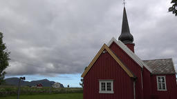 Norway Lofoten islands Flakstad Church with amazing cloud cover above ビデオ