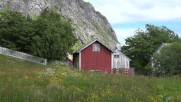 Norway Lofoten islands meadow and landscape behind Flakstad Church GIF
