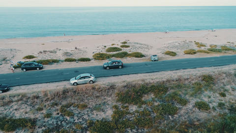 Aerial view of car on beach road Live Action