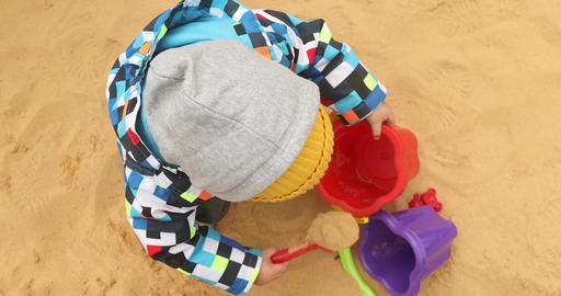 Child is digging the sand coldly Footage