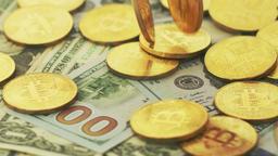 Golden bitcoins and money bills Footage