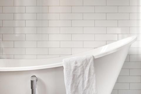 Towel on classic bathroom with old bathtub Photo