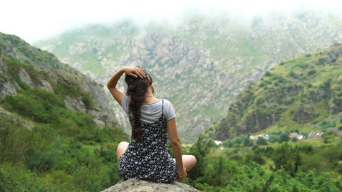 Woman Relaxes By Mountains Stock Video Footage
