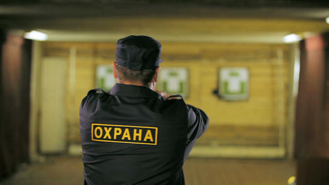 security service worker trains shooting from pistol Footage