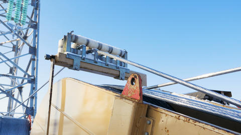 wire rope coiled on large bobbin against blue sky Live Action