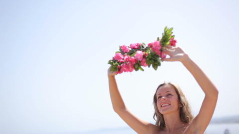 bride in white dress with wreath on the beach Footage