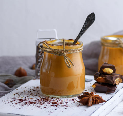 Caramel dessert Toffee in a glass jar Photo