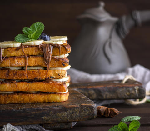 square fried bread slices with chocolate and banana Photo