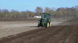 Farming tractor plowing rough land on agricultural field before sowing seeds Footage