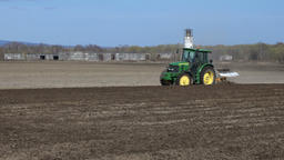 Modern tractor plowing rough land on agricultural field before sowing seeds Footage