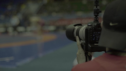 The photographer takes pictures at the championship in wrestling Footage