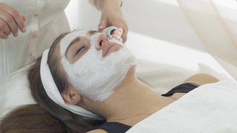 Close up darsonvalization face of girl with mask in saloon. Cosmetic procedure Footage