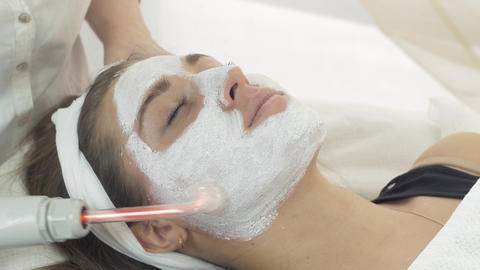Close up darsonvalization girl face with mask in saloon. Cosmetic procedure Footage