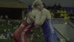 Men athletic wrestlers fight each other in the tournament Footage